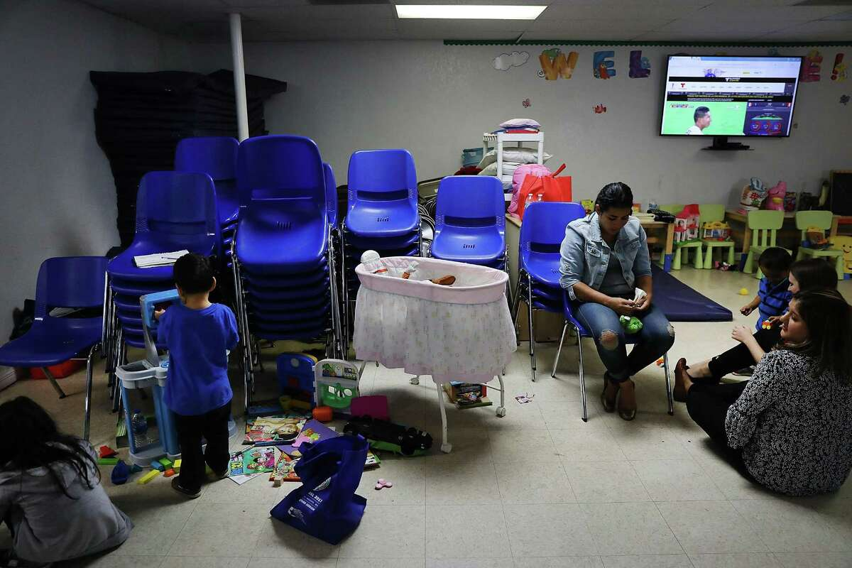 MCALLEN, TX - JUNE 21: Recently arrived migrant families speak with volunteers at the Catholic Charities Humanitarian Respite Center on June 21, 2018 in McAllen, Texas. Once families and individuals are released from Customs and Border Protection to continue their legal process, they are brought to the center to rest, clean up, enjoy a meal and get guidance to their next destination. Before Trump signed an executive order yesterday that the administration says halts the practice of separating families seeking asylum, more than 2,300 immigrant children had been separated from their parents in the zero-tolerance policy for border crossers. (Photo by Spencer Platt/Getty Images)