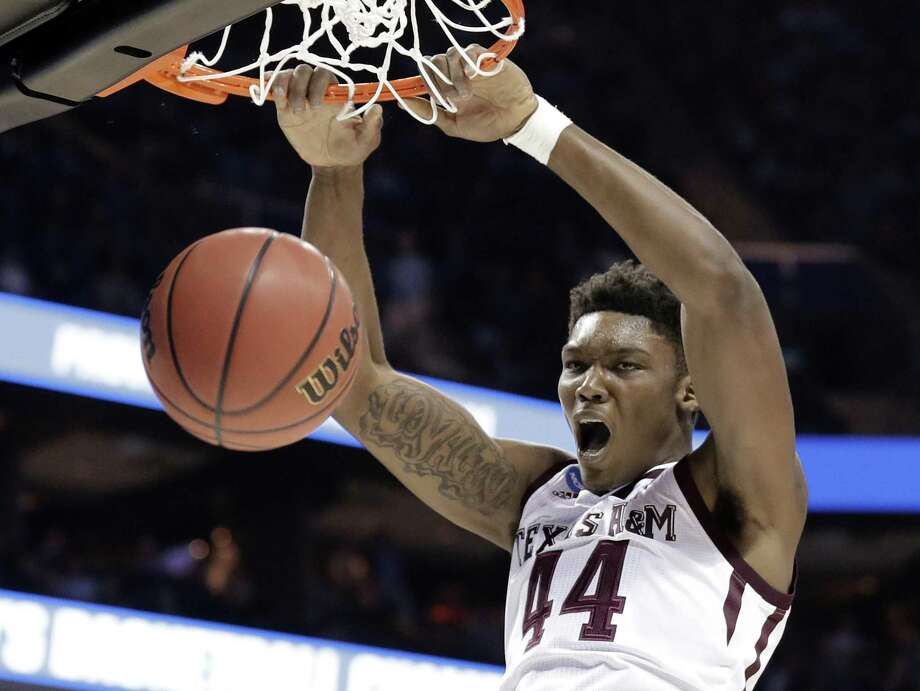 Texas A&M's Robert Williams dunks against Providence during the second half of a first-round game in the NCAA men's college basketball tournament in Charlotte, N.C., Friday, March 16, 2018. (AP Photo/Gerry Broome) Photo: Gerry Broome, STF / Associated Press / Copyright 2018 The Associated Press. All rights reserved.
