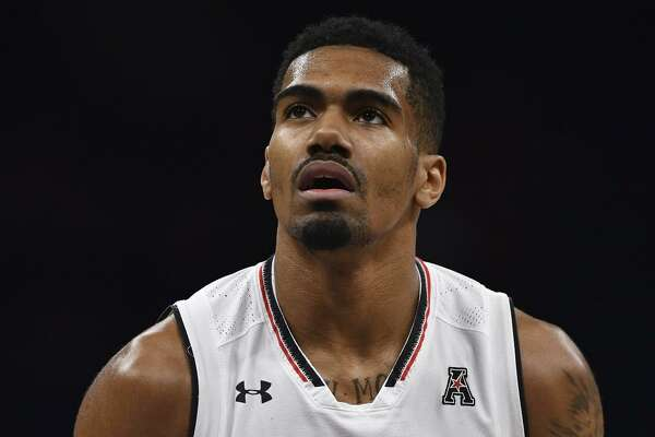 Jacob Evans #1 of the Cincinnati Bearcats attempts a free throw during the final game of the 2018 AAC Basketball Championship against the Houston Cougars at Amway Center on March 11, 2018 in Orlando, Florida.