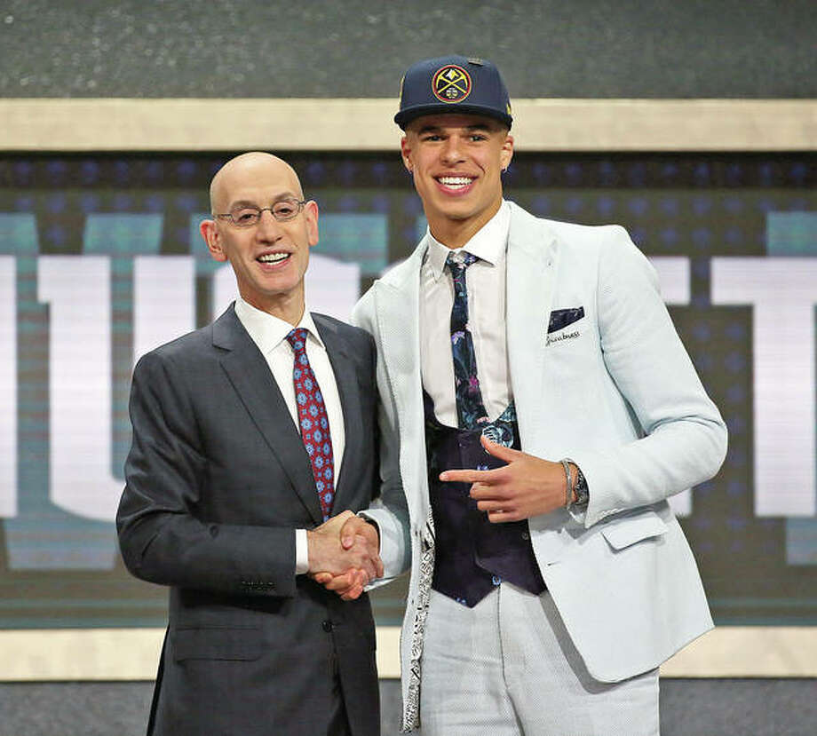 Missouri's Michael Porter Jr., right, poses with NBA Commissioner Adam Silver after he was picked 14th overall by the Denver Nuggets Thursday in the NBA basketball draft in New York.