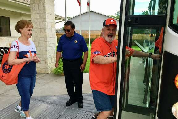 Jean Miles, left, follows Gary Ankrum to a bus bound for Minute Maid Park, courtesy of Katy's Fussell Senior Center, which has organized AARP-sponsored trips to Astros games for 46 years.