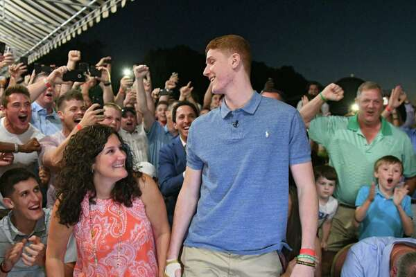 Shenendehowa graduate Kevin Huerter looks at his mother Erin after he is picked by the Atlanta Hawks in the first round of the 2018 NBA Draft, 19th overall, at the Edison Club on Thursday, June 21, 2018 in Rexford, N.Y. (Lori Van Buren/Times Union)