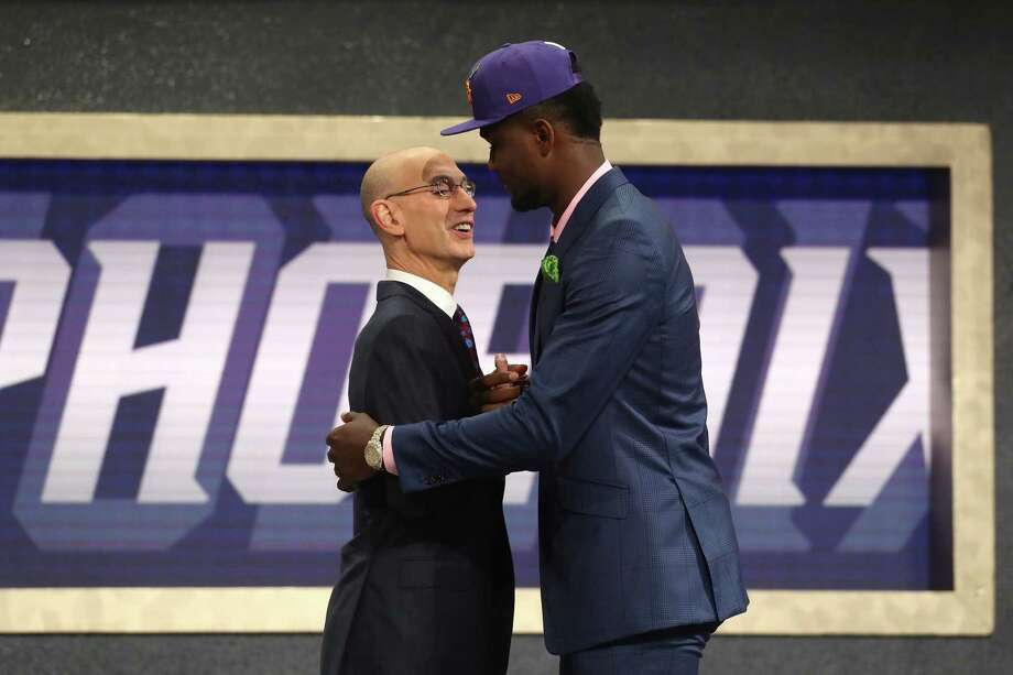 NEW YORK, NY - JUNE 21:  Deandre Ayton poses with NBA Commissioner Adam Silver after being drafted first overall by the Phoenix Suns during the 2018 NBA Draft at the Barclays Center on June 21, 2018 in the Brooklyn borough of New York City. NOTE TO USER: User expressly acknowledges and agrees that, by downloading and or using this photograph, User is consenting to the terms and conditions of the Getty Images License Agreement.  (Photo by Mike Stobe/Getty Images) Photo: Mike Stobe / 2018 Getty Images