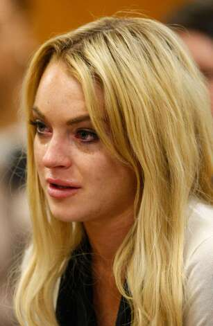 LOS ANGELES, CA - JULY 06:  Actress Lindsay Lohan cries during her probation revocation hearing at the Beverly Hills Courthouse on July 6, 2010 in Los Angeles, California. Lindsay Lohan was found in violation of her probation for the August 2007 no-contest plea to drug and alcohol charges stemming from two separate traffic accidents, she is scheduled to surrender on July 20, 2010 to serve her 90 day jail sentence.  (Photo by David McNew/Getty Images) *** Local Caption *** Lindsay Lohan Photo: David McNew, Getty Images / 2010 Getty Images