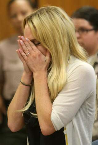 LOS ANGELES, CA - JULY 06:  Actress Lindsay Lohan attends her probation revocation hearing at the Beverly Hills Courthouse on July 6, 2010 in Los Angeles, California. Lindsay Lohan was found in violation of her probation for the August 2007 no-contest plea to drug and alcohol charges stemming from two separate traffic accidents, she is scheduled to surrender on July 20, 2010 to serve her 90 day jail sentence.  (Photo by David McNew/Getty Images) *** Local Caption *** Lindsay Lohan Photo: David McNew, Getty Images / 2010 Getty Images