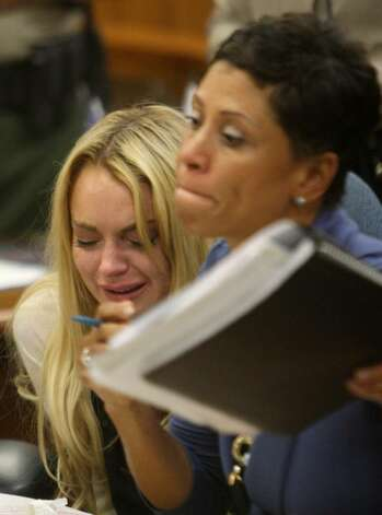 LOS ANGELES, CA - JULY 06:  Actress Lindsay Lohan (L) and lawyer Shawn Chapman Holley attend a probation revocation hearing at the Beverly Hills Courthouse on July 6, 2010 in Los Angeles, California. Lindsay Lohan was found in violation of her probation for the August 2007 no-contest plea to drug and alcohol charges stemming from two separate traffic accidents, she is scheduled to surrender on July 20, 2010 to serve her 90 day jail sentence.  (Photo by David McNew/Getty Images) *** Local Caption *** Lindsay Lohan;Shawn Chapman Holley Photo: David McNew, Getty Images / 2010 Getty Images