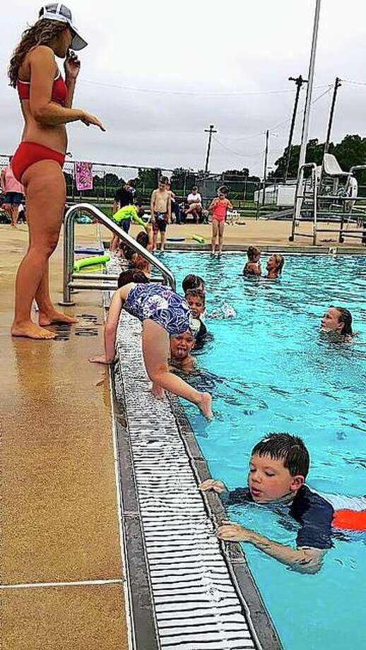 The cold water of the Winchester pool provides a relief from the heat for those taking swimming lessons. Photo:       Jerry Stocker | Reader Photo