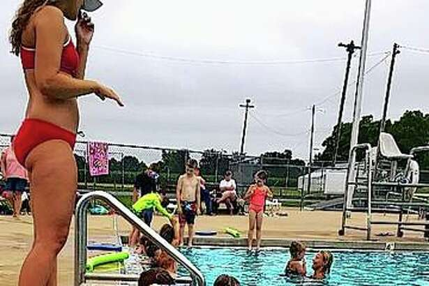 The cold water of the Winchester pool provides a relief from the heat for those taking swimming lessons.