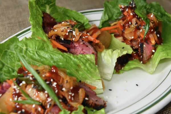 Beef bulgogi lettuce wraps - local bibb lettuce, fire grilled beef bulgogi, house-made kim-chi, sesame seeds at The Hen & The Hound Bistro on Thursday, June 14, 2018 in Middleburgh, N.Y. (Lori Van Buren/Times Union)