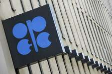 An OPEC sign hangs outside the OPEC Secretariat ahead of the the 174th Organization Of Petroleum Exporting Countries (OPEC) meeting in Vienna, Austria, on Thursday, June 21, 2018. The odds of OPEC reaching an oil-production deal increased as Iran edged away from a threat to veto any agreement that would raise output and Saudi Arabia put forward a plan that would add about 600,000 barrels a day to the global market. Photographer: Stefan Wermuth/Bloomberg