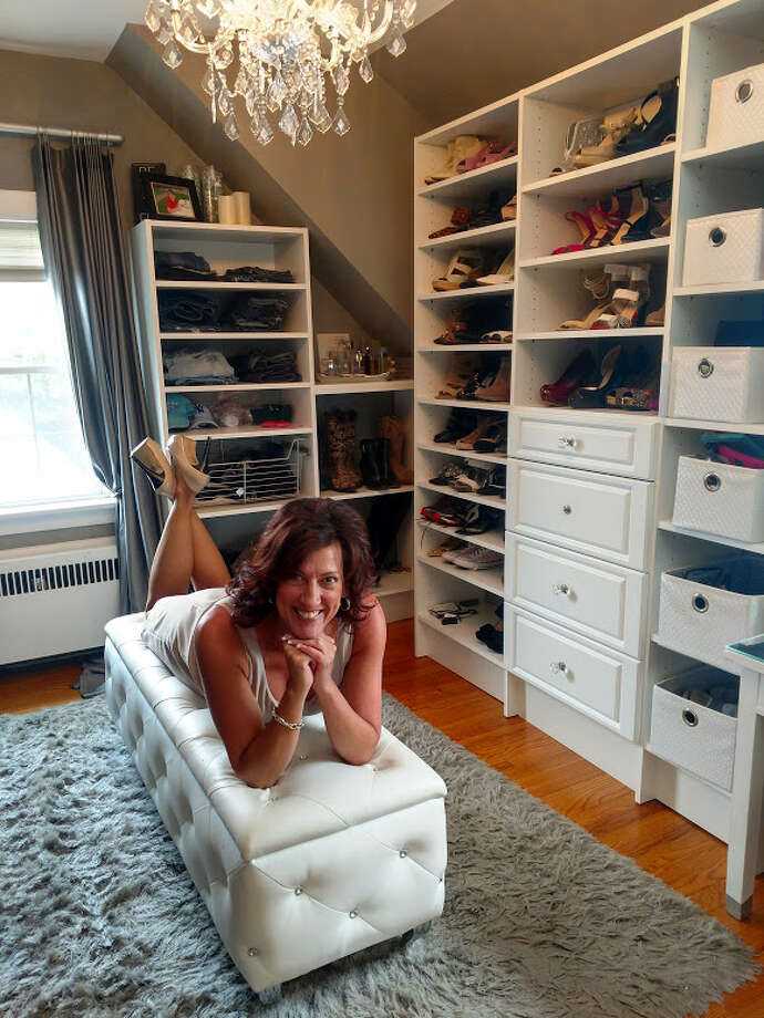 "Joella Viscusi poses inside her ""dream"" walk-in closet at her home in Albany, N.Y. on Wednesday, June 20, 2018. The closet was previously her stepson's room. (Photo by Trish Rost)"