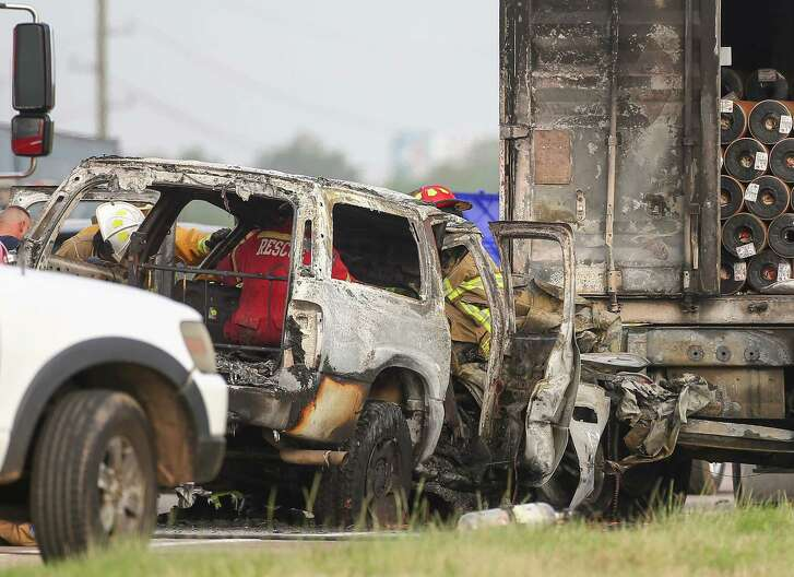 Authorities investigate the scene of a crash, where one person died in fire that resulted from the incident on the westbound lanes of Interstate 10 near Woods Road Friday, June 22, 2018, in Brookshire, Texas.