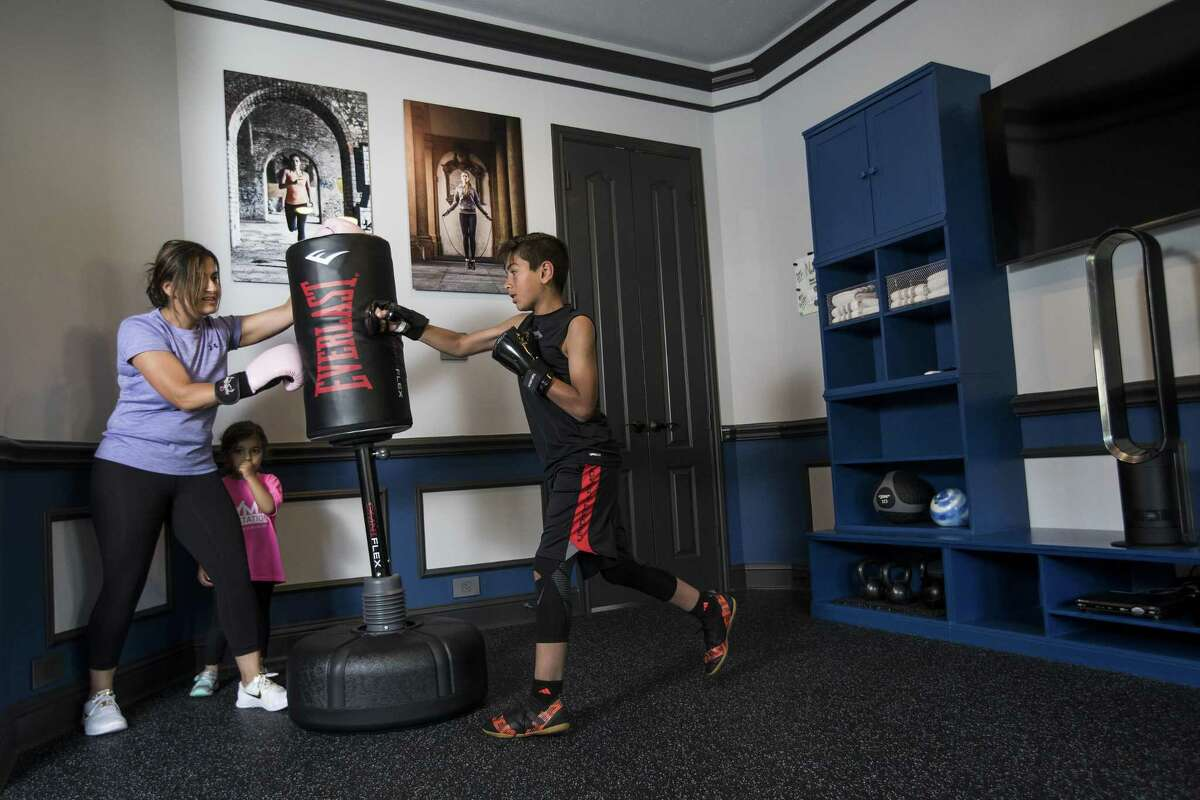 Neda Malkani works out with her son, Armaan, 11, in her excercise room, that was once a formal dining room at her home, on Friday, June 1, 2018, in Humble. ( Brett Coomer / Houston Chronicle )
