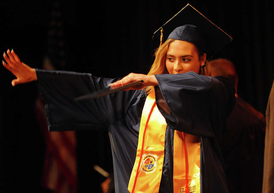 Graduate Aleisha Santiago dabs after receiving her diploma at the Bridgeport Military Academy graduation at the University of Bridgeport in Bridgeport, Conn. on Friday, June 22, 2018. Photo: Brian A. Pounds, Hearst Connecticut Media / Connecticut Post
