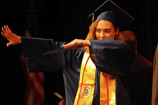 Graduate Aleisha Santiago dabs after receiving her diploma at the Bridgeport Military Academy graduation at the University of Bridgeport in Bridgeport, Conn. on Friday, June 22, 2018.