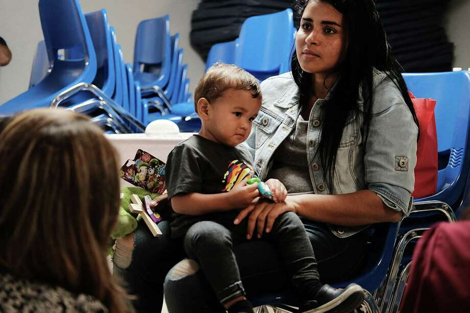MCALLEN, TX - JUNE 21: A woman who idendtified herself as Jennifer sits with her son Jaydan at the Catholic Charities Humanitarian Respite Center after recently crossing the U.S., Mexico border on June 21, 2018 in McAllen, Texas. Once families and individuals are released from Customs and Border Protection to continue their legal process, they are brought to the center to rest, clean up, enjoy a meal and get guidance to their next destination. Before Trump signed an executive order yesterday that the administration says halts the practice of separating families seeking asylum, more than 2,300 immigrant children had been separated from their parents in the  zero-tolerance policy for border crossers. (Photo by Spencer Platt/Getty Images) Photo: Spencer Platt / Getty Images / 2018 Getty Images