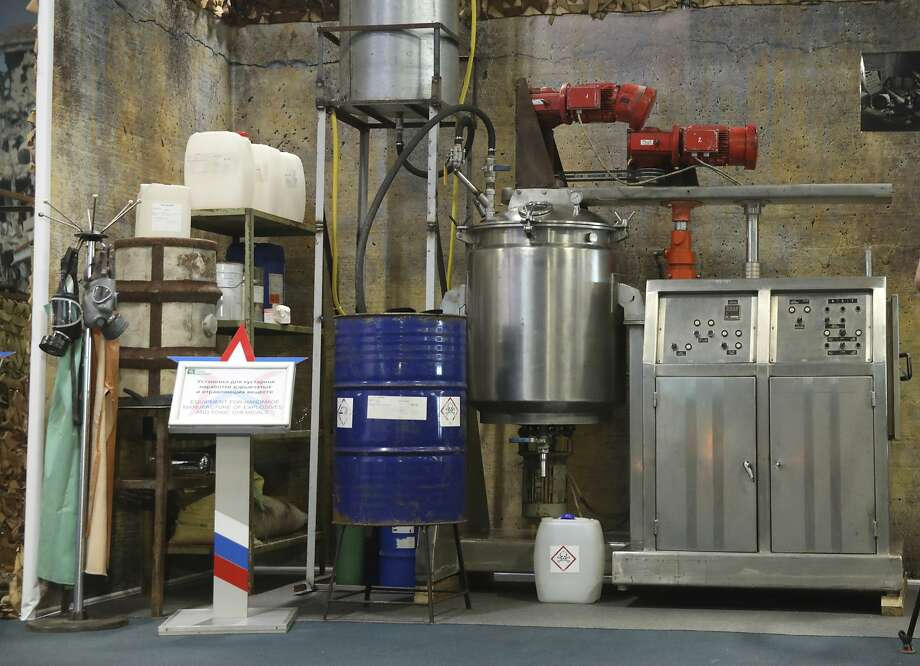 Russian officials display a chemical lab capable of making toxic compounds that they say was seized from rebels in the Syrian town of Douma. Photo: Associated Press