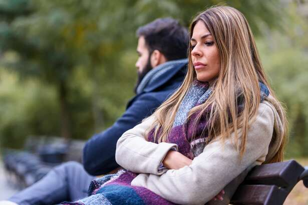 Couple sitting in park having relationship problems. Break up