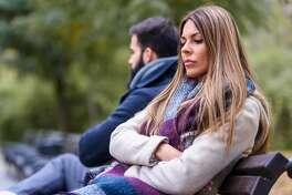 Couple sitting in park having relationship problems. Break up