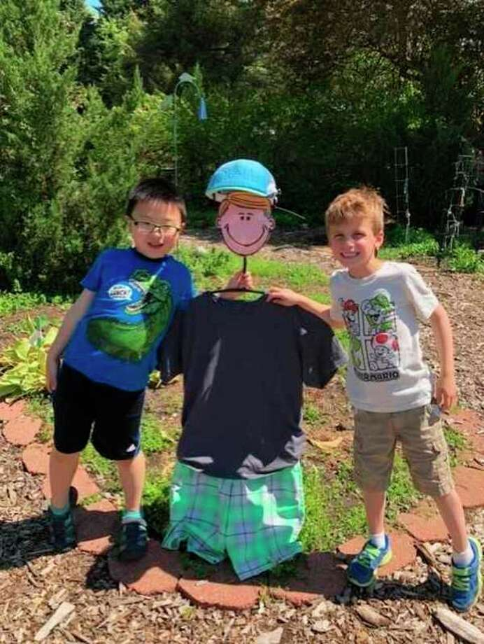 Kindergarteners Jayden Wu and David Sias with Chester. (Photo provided)
