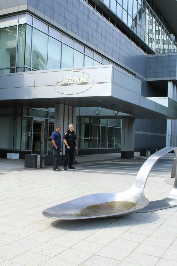 A massive spoon was deposited Friday morning, June 22, 2018, outside of the Stamford headquarters of pharmaceutical giant Purdue Pharma. Photo: Barry Lytton