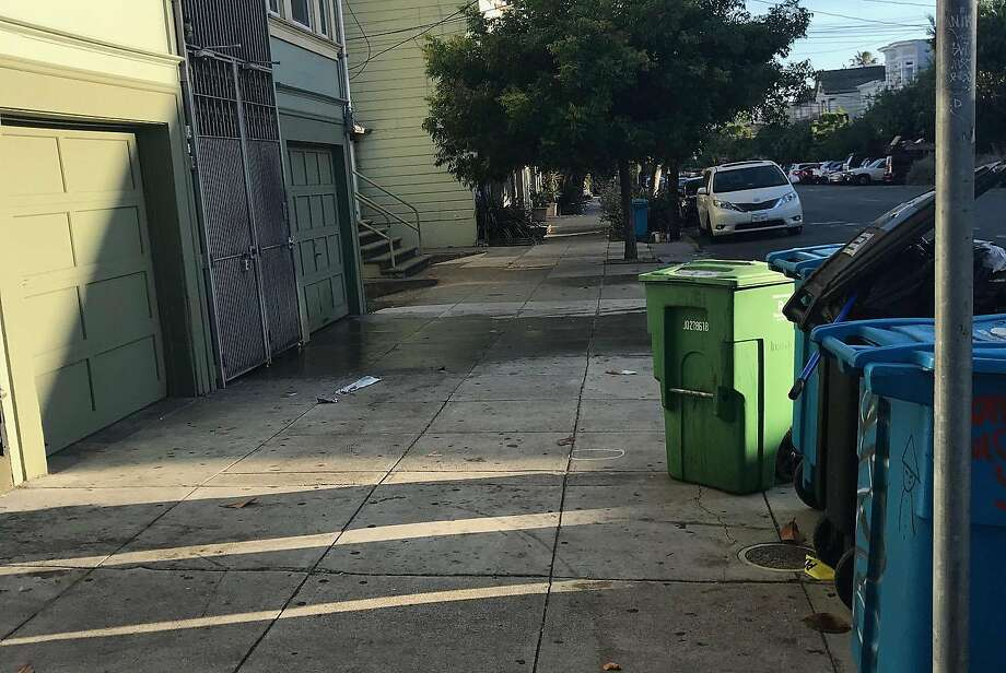 An early morning shooting Friday on the 2700 block of Harrison Street in San Francisco�s Mission District left one person dead and another seriously injured, authorities said. A piece of crime scene tape remained on the scene Friday morning under some garbage cans. Photo: Megan Cassidy, The Chronicle