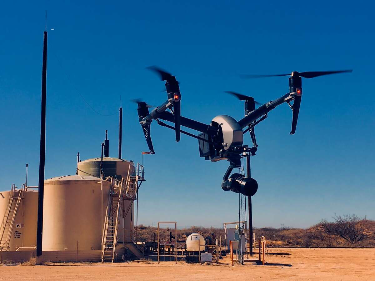 A drone utilizing sensors customized by Avitas Systems, conducts inspections of oil and gas facilities.