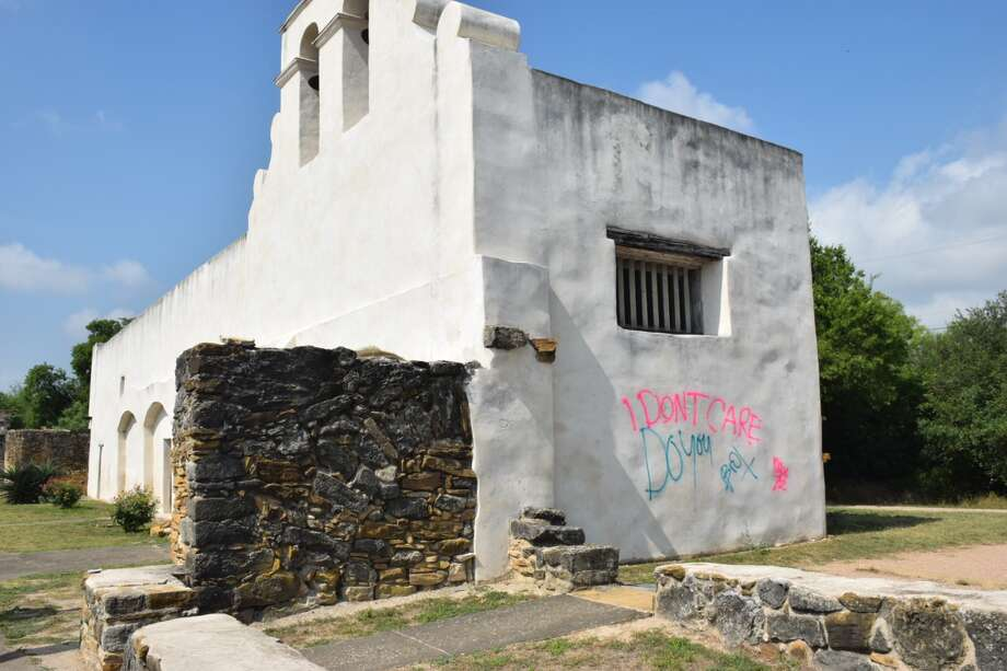 """""""I don't care. Do you?"""" vandals wrote at Mission San Juan on Friday, June 22, 2018. Photo: Caleb Downs"""