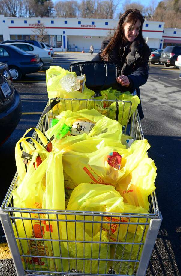 Victoria Pagan, of Ansonia, at Shop Rite in Shelton, Conn., on Saturday Jan. 10, 2015. The state is considering a ban on plastic bags like the ones in the cart. If outlawed buyers would be forced to either bring their own bags or pay for store paper bags. Photo: Christian Abraham, Staff Photographer / Christian Abraham / Connecticut Post