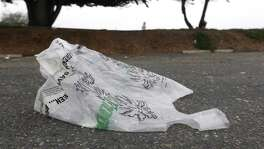 A plastic grocery bag blows across a Berkeley Marina parking lot in Berkeley, Calif. on Friday, Sept. 9, 2016. Two statewide initiatives on the November ballot, Props. 65 and 67, concern the use of plastic grocery bags.