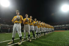 Little Cypress-Mauriceville's team lines up for the National Anthem before starting against Robinson during game one of the Class 4A region III tournament Thursday at the University of Houston baseball stadium. Photo taken Monday, June 2, 2016 Kim Brent/The Enterprise