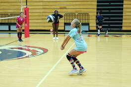 Allix Carder sets the ball during a hitting drill at the Dawson summer volleyball camp.