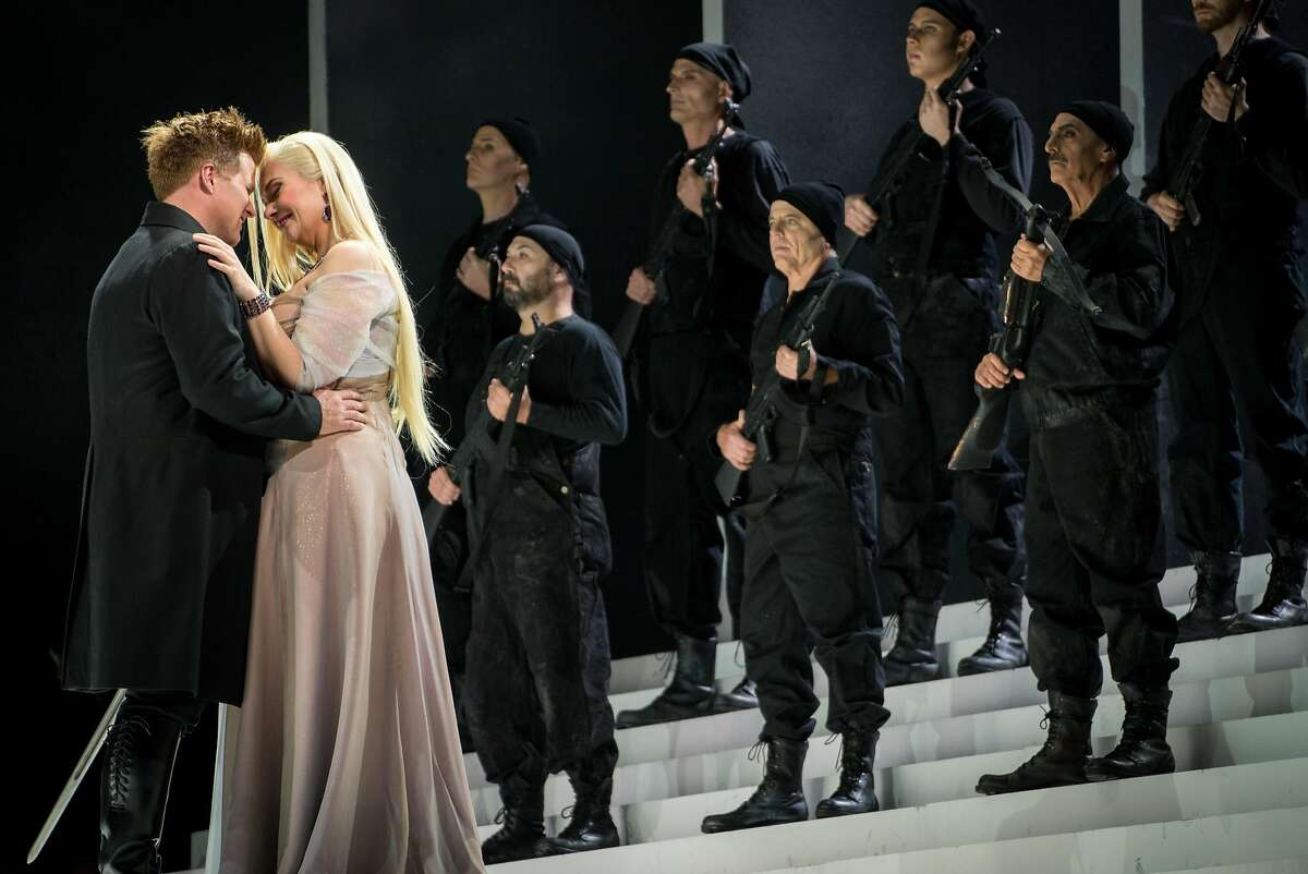 Siegfried (Daniel Brenna) and Gutrune (Melissa Citro) embrace during the final dress rehearsal for Richard Wagner's four-part Ring cycle, G�tterd�mmerung, at the War Memorial Opera House in San Francisco, Calif. on Sunday, June 10, 2018.