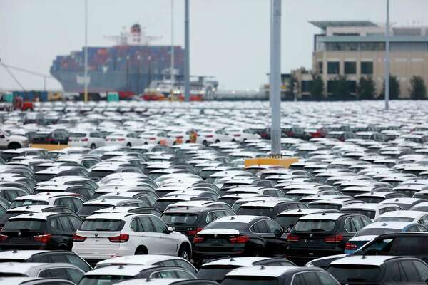 Bayerische Motoren Werke vehicles, assembled in the U.S., sit parked before being driven onto vehicle carrier ships at the Port of Charleston in Charleston, South Carolina,on Oct. 4, 2016.