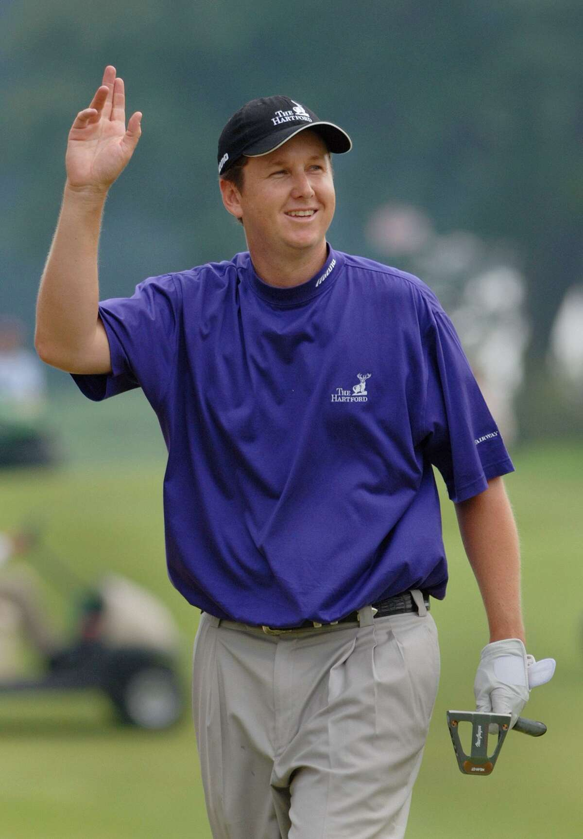 J.J. Henry acknowledges the crowd as he walks up the 18th fairway of the Tournament Players Club during the final round of the 2006 Buick Championship in Cromwell. Henry became the first Connecticut native to win the event.