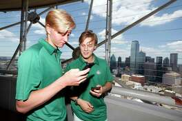 Rasmus Dahlin, left, and Adam Boqvist, both of Sweden, share photos on social media in Dallas, Thursday, June 21, 2018. The NHL hockey draft takes place Friday and Saturday in Dallas.