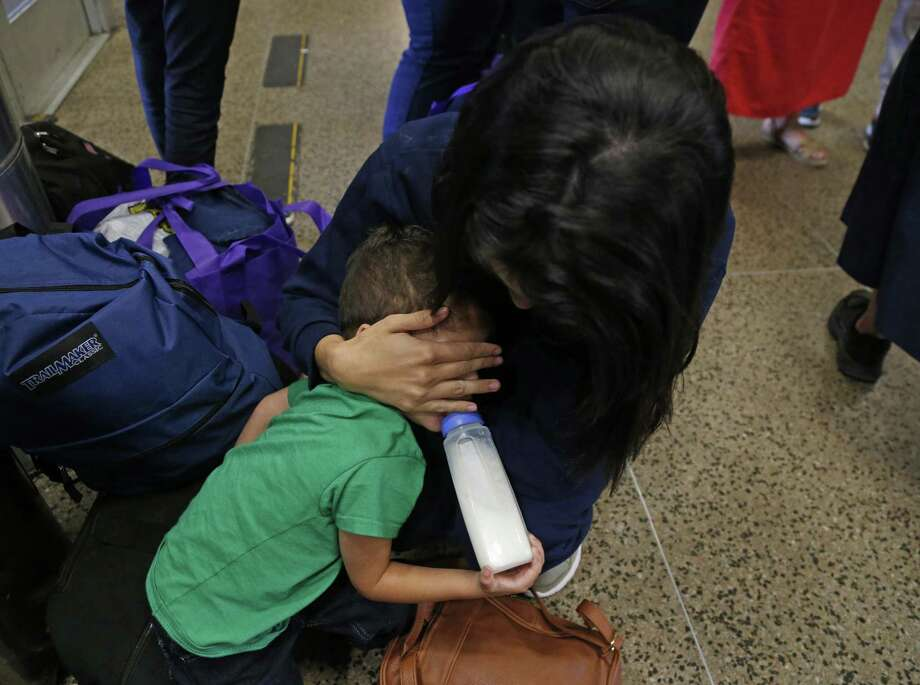 These mothers and children were waiting for a bus to a another location at Greyhound Bus Station on Thursday, June 21,2018. Photo: Ronald Cortes, For The San Antonio Express News / 2018 Ronald Cortes