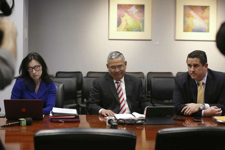 City of San Antonio officials from left, First Assistant City Attorney Elizabeth Provencio, City Attorney Andrew Segovia and Deputy City Manager Erik J. Walsh, sit at a table prepared to negotiate with the San Antonio firefighters union during a press conference at City Hall, Tuesday, March 13, 2018. Photo: JERRY LARA / San Antonio Express-News / © 2018 San Antonio Express-News