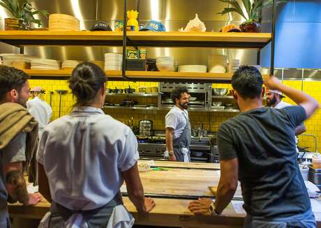 Chef Ravi Kapur talks with the staff in the open kitchen of of Liholiho Yacht Club on Thursday, Sept. 17, 2015 in San Francisco, Calif. Chef James Babian and General Manager Teddy Lyau of Pueo�s Osteria, a lively indoor/outdoor Italian-inspired restaurant located in Waikoloa Village on the �west side� of Hawaii Island, visit Liholiho Yacht Club on Sutter street.