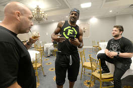 Beaumont MMA fighter Ryan Spann (right) talks with LFA workers while stopping in at fighter weigh-ins for LFA 43 contenders at the MCM Elegante Hotel Thursday, June 21. Spann is signing with the UFC after earning his belt in the LFA. Thursday, June 21, 2018 Kim Brent/The Enterprise