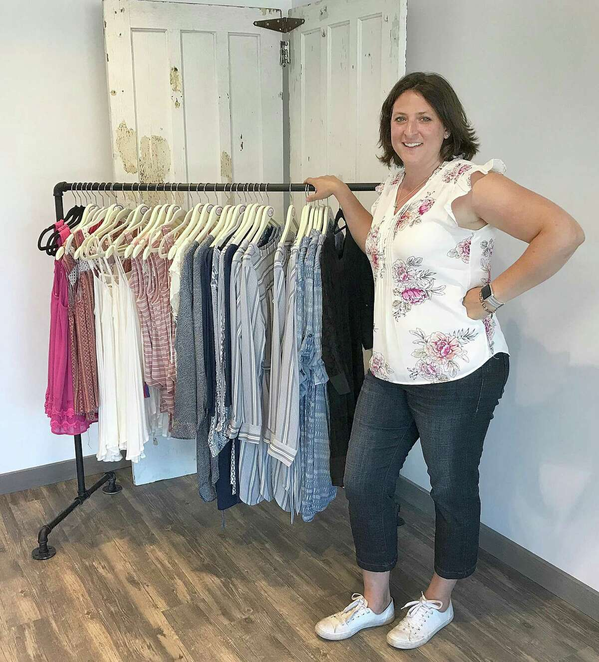 Bobbi Jo Beers of Traveling Chic Boutique stands in her new retail location in Brookfield Village in Brookfield, Conn., on Thursday, June 21, 2018.