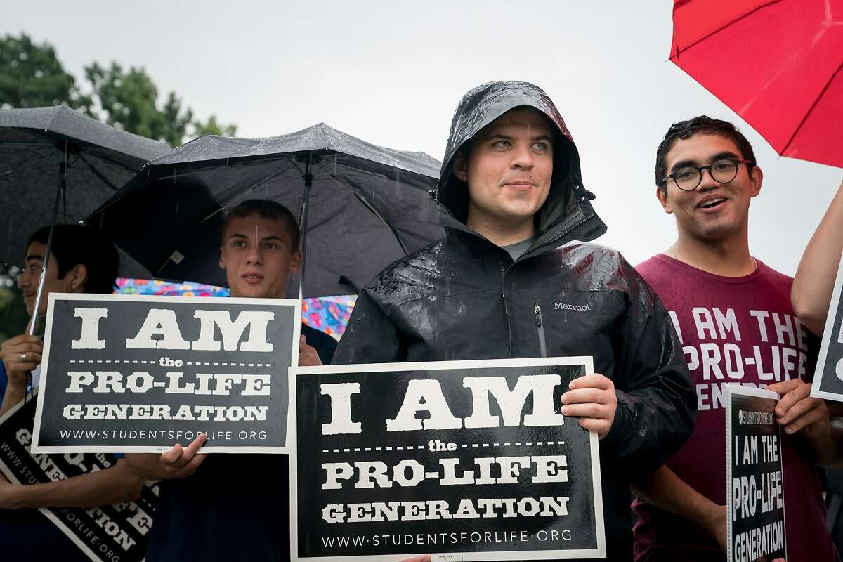 Activists with Students for Life in America, a group opposed to abortion, demonstrate outside the U.S. Supreme Court in Washington, June 22, 2018. (Erin Schaff/The New York Times)