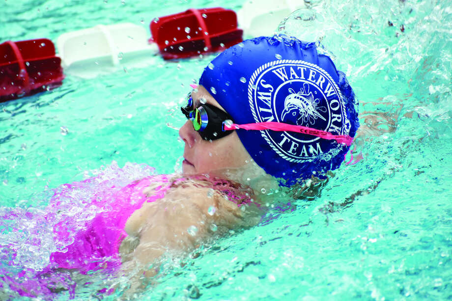 Water Works swimmer Karissa Osborn competes in the backstroke portion of the 9-10 200-meter medlay relay during a home meet against the Gators on Thursday.