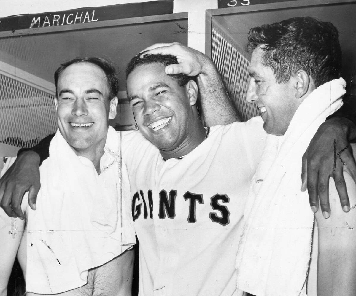 San Francisco Giants pitcher Juan Marichal, shown here in 1963, was an opening day starter in 1962, 1964 to 1969, and 1971-1973. In this photo Marichal is celebrating with teammates Chuck Hiller and Jimmy Davenport after throwing a no-hitter 6/15/1963 Photo ran 06/16/1963, p. 32