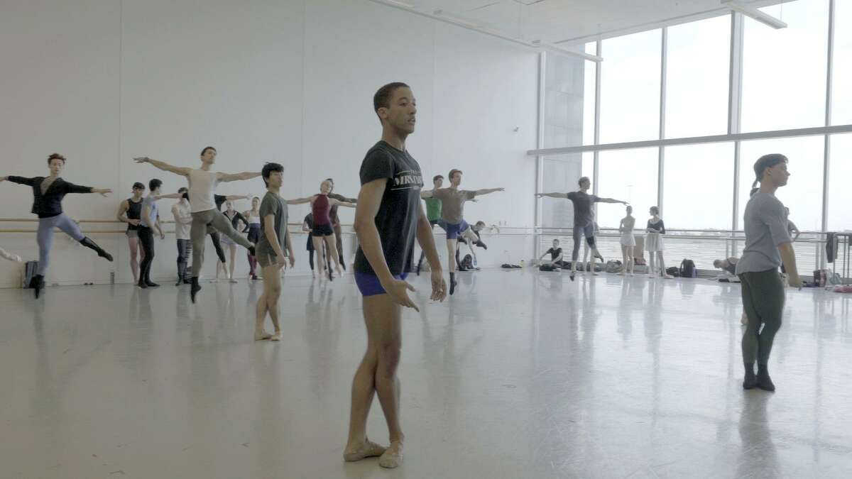 """Houston Ballet soloist Harper Watters, center, and other artists of the company in a class filmed for the documentary """"Danseur."""""""