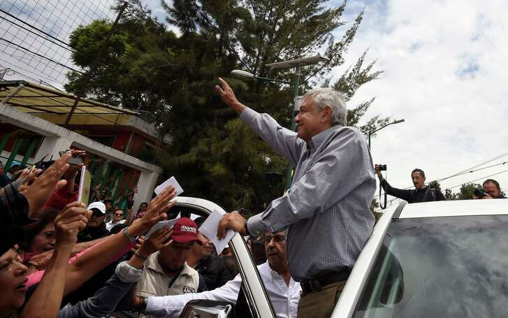 Mexico's presidential candidate for the MORENA party, Andres Manuel Lopez Obrador, greets supporters after a campaign rally in Los Reyes Acaquilpan, La Paz municipality, state of Mexico, on June 20, 2018 ahead of the upcoming July 1 national election.   / AFP PHOTO / ALFREDO ESTRELLAALFREDO ESTRELLA/AFP/Getty Images