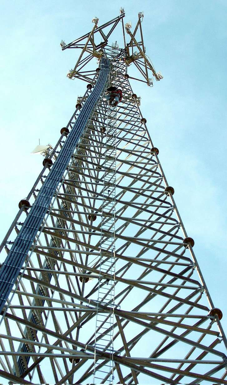 Chris Bynum of MTSI,  begins his climb down a cell phone tower in Blossom, Texas, Wednesday, Dec. 27, 2006 after a routine maintenance call.   (AP Photo /The Paris News, Sam Craft)  ** MANDATORY CREDIT **    Ran on: 01-14-2007 Apple CEO Steve Jobs shows off the iPhone during its premiere at the Macworld Expo last week at Moscone Center in San Francisco. Ran on: 01-14-2007 Apple CEO Steve Jobs shows off the iPhone during its premiere at the Macworld Expo last week at Moscone Center in San Francisco.