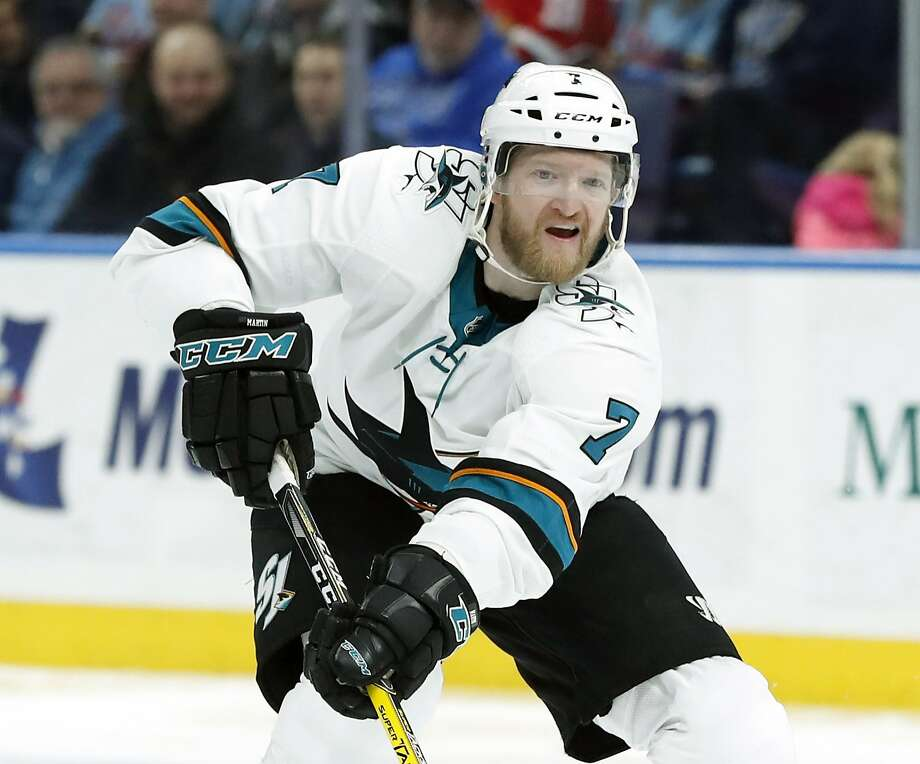 The Sharks put Paul Martin on unconditional waivers Friday with the intention to buy out the remaining season of his contract. Photo: Jeff Roberson / Associated Press