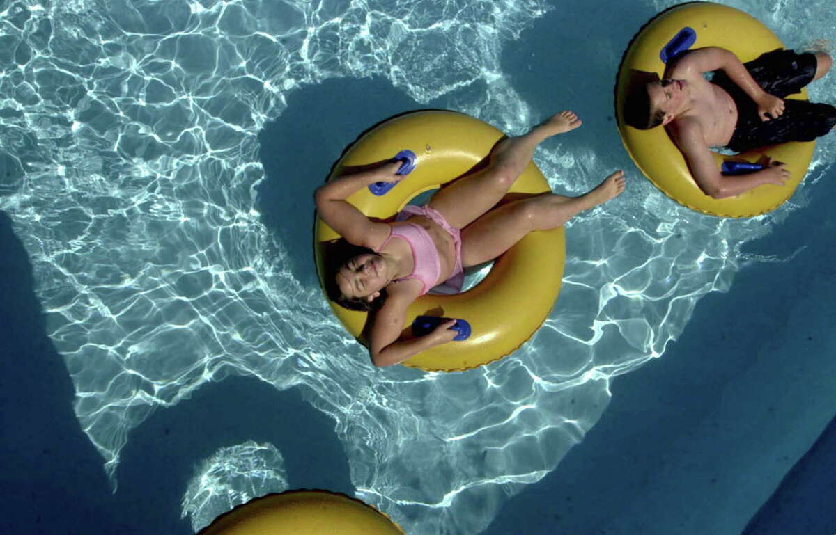 Catherine Fleming, 10, left, and her brother James Fleming, 12, both from Vista, NY, enjoy the end-of-the-summer-season tube ride at the Water Slide World Park, Thursday, August 28, 2003 (Times Union photo by STEVE JACOBS)