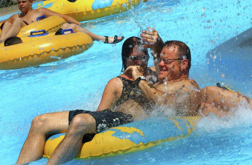 Jim Corkery and his wife, Elizabeth Corkery, of Connecticut on the tube ride at Water Slide World in Lake George, New York Wednesday July 3, 2002. (TIMES UNION STAFF PHOTO--MICHAEL P. FARRELL)